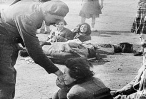 Woman clings to solider at the liberation of Bergen-Belsen